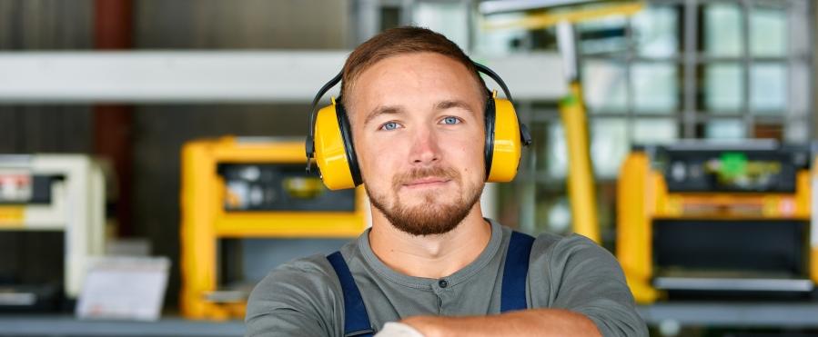 Young Workman Wearing Earmuffs